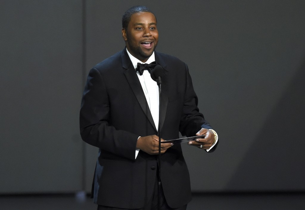 FILE - Kenan Thompson presents the award for outstanding drama series at the 70th Primetime Emmy Awards on Sept. 17, 2018, in Los Angeles. Thompson tu...