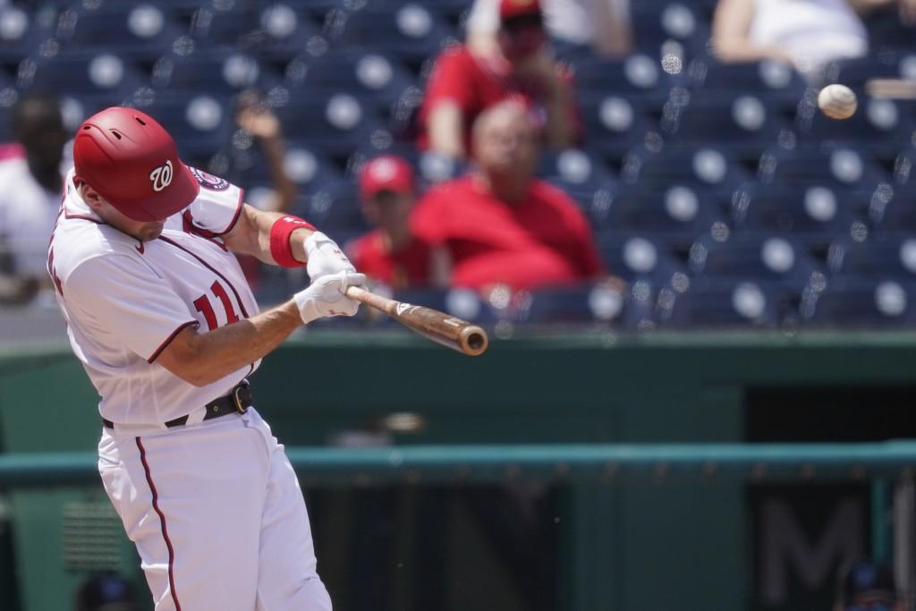 Washington Nationals Ryan Zimmerman hits a three-run homer during the third inning of a baseball game against the Miami Marlins at Nationals Park, Sun...
