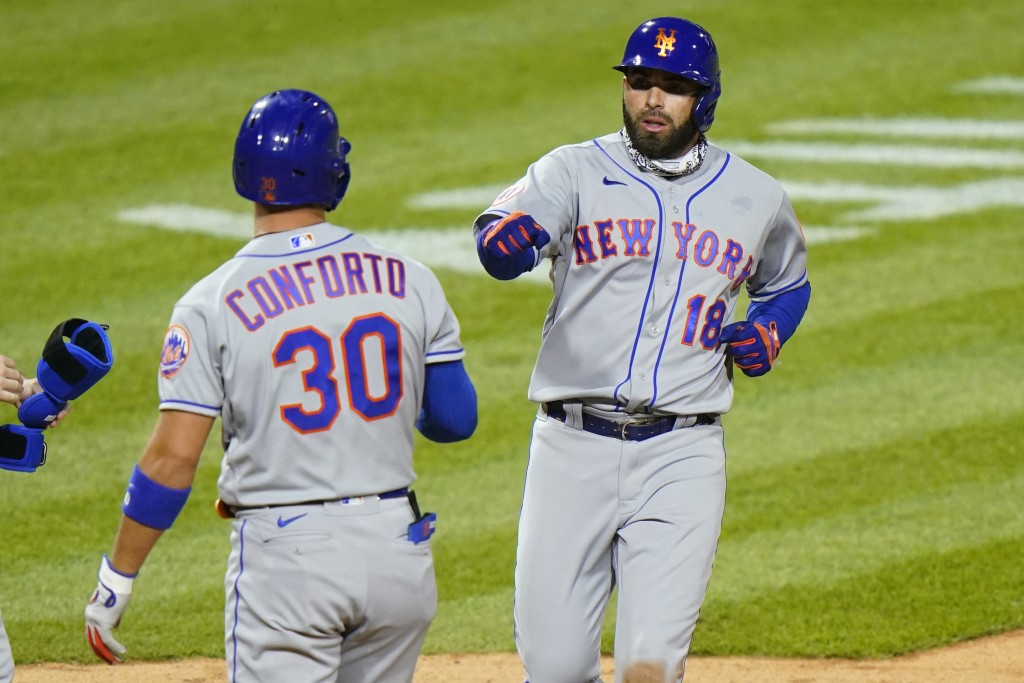 New York Mets' Jose Peraza, right, celebrates with Michael Conforto after Peraza was walked home on Conforto's at-bat against Philadelphia Phillies pi...