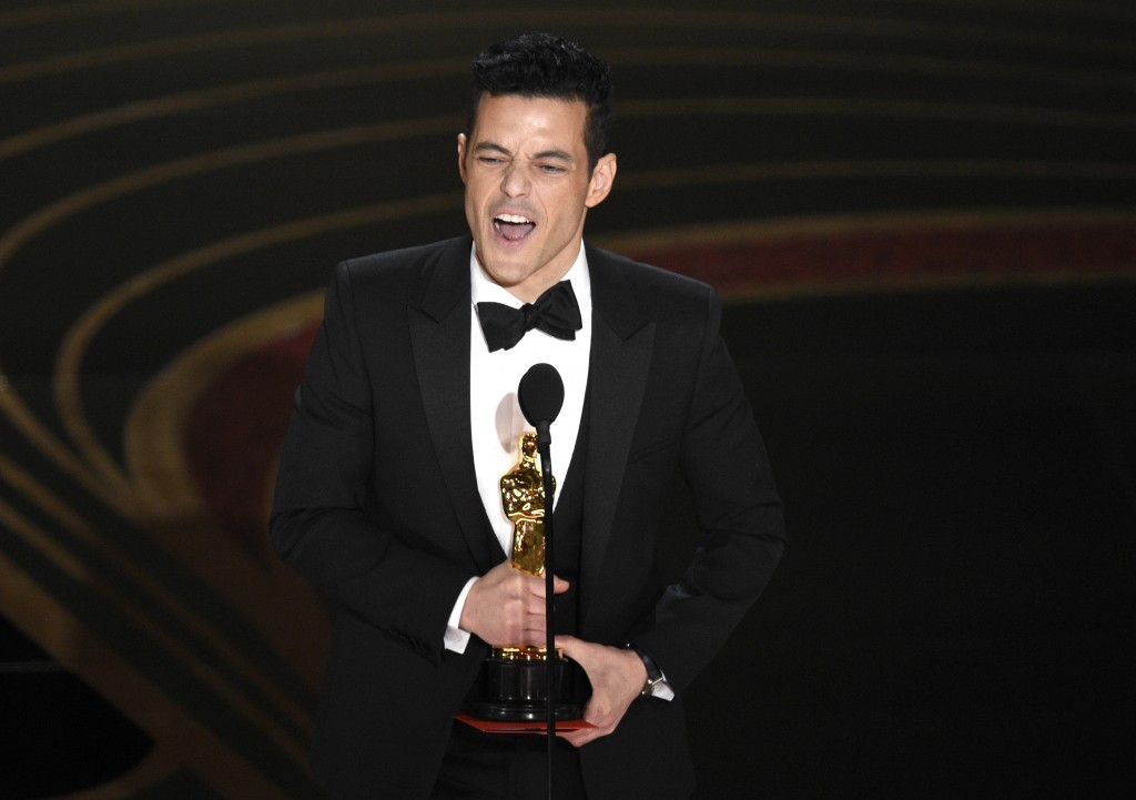 """FILE - Rami Malek accepts the award for best performance by an actor in a leading role for """"Bohemian Rhapsody"""" at the Oscars on Feb. 24, 2019, in Los ..."""