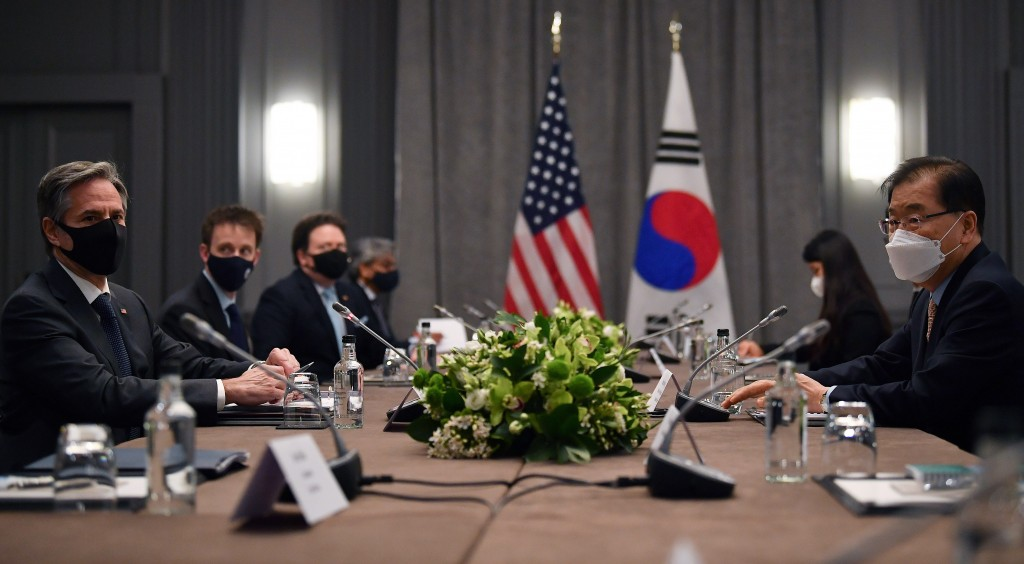 United States Secretary of State Antony Blinken, left, wearing a face mask to curb the spread of coronavirus, speaks to South Korea's Foreign Minister...
