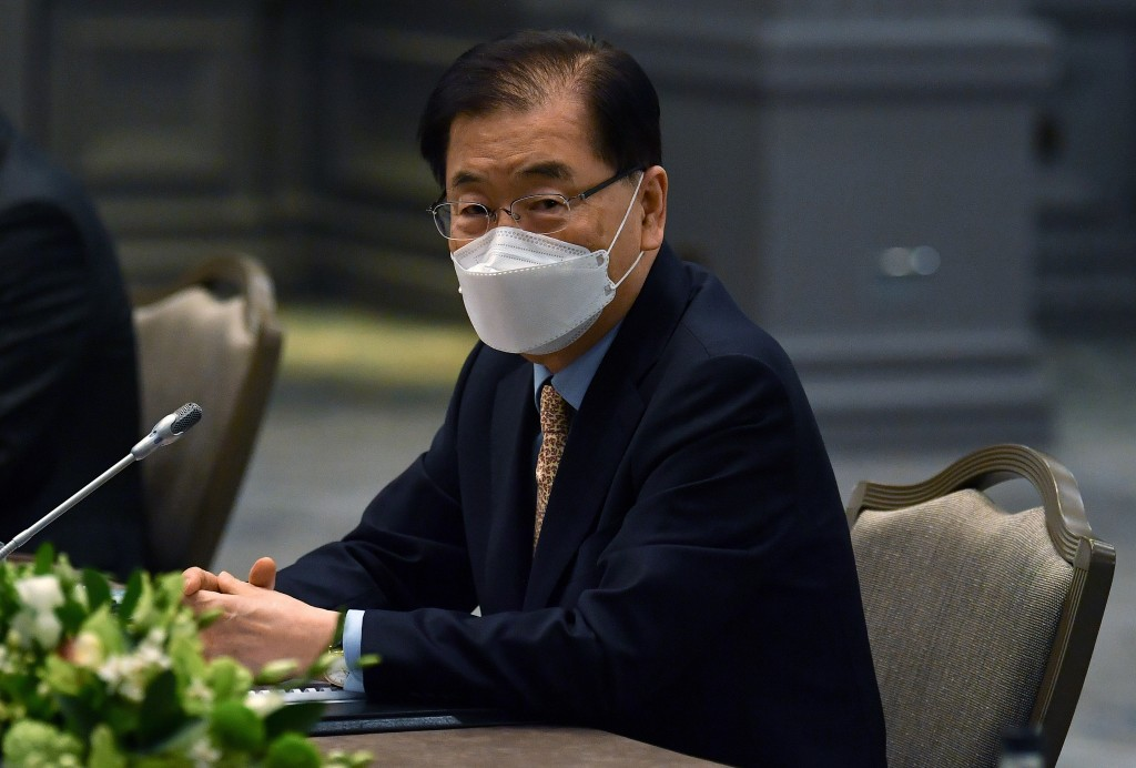 South Korea's Foreign Minister Chung Eui-yong, wearing a mask to protect against coronavirus, speaks with US Secretary of State Antony Blinken , durin...