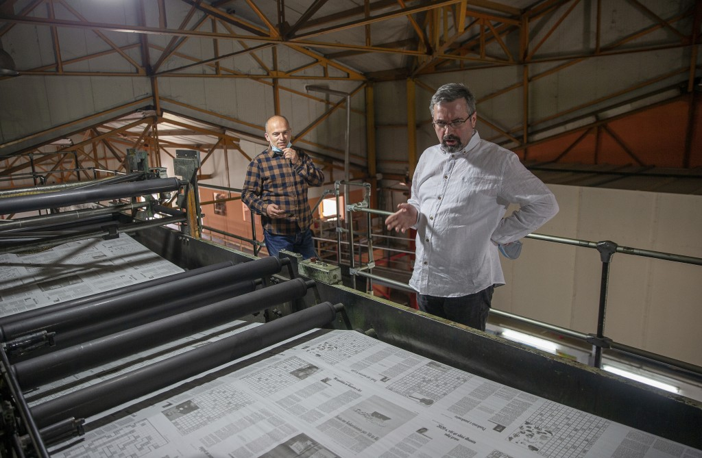 Agron Bajrami, front, editor-in-chief of Koha daily newspaper joined by administrator of Koha printing house, Nexhmedin Berisha, inspect the last issu...