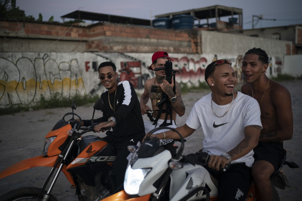 """Trap de Cria artists Marcos Borges, known as """"MbNaVoz,"""" from left, Wesley Souza """"MC Branquinho,"""" Fernando """"Barbeirin"""" and Pablo """"PBSant"""" ride motorcyc..."""