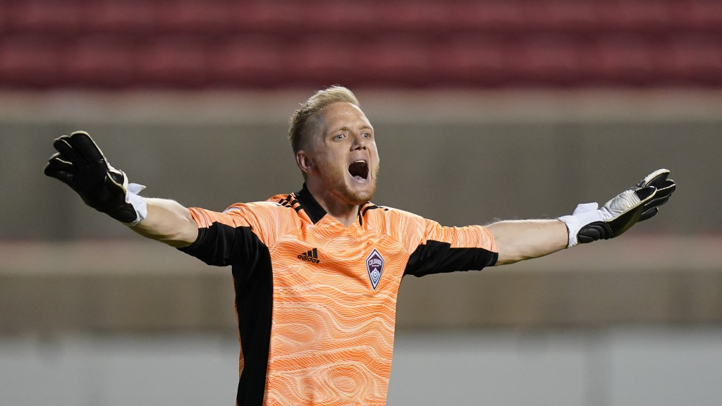 Colorado Rapids goalkeeper William Yarbrough (22) directs his team in the second half of an MLS soccer game against the Vancouver Whitecaps, Sunday, M...