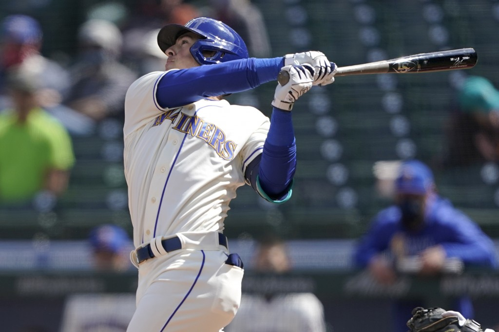 Seattle Mariners' Dylan Moore hits an RBI single to score Kyle Seager in the fourth inning of a baseball game against the Los Angeles Angels, Sunday, ...