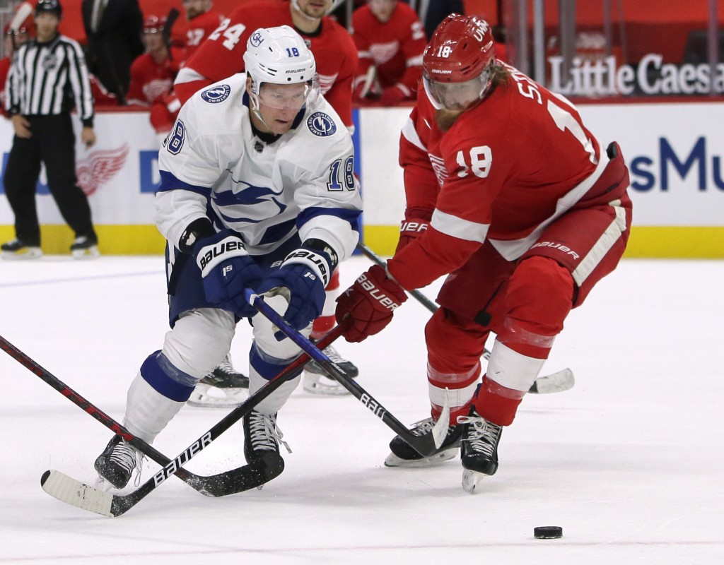 Tampa Bay Lightning left wing Ondrej Palat (18) battles for the puck with Detroit Red Wings defenseman Marc Staal (18) during the first period of an N...