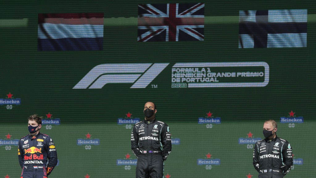 Second placed Red Bull driver Max Verstappen of the Netherlands, winner Mercedes driver Lewis Hamilton of Britain and third placed Mercedes driver Val...