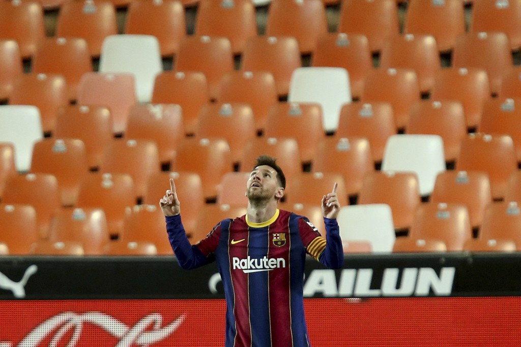 Barcelona's Lionel Messi celebrates scoring his side's 3rd goal during the Spanish La Liga soccer match between Valencia and Barcelona at the Mestalla...