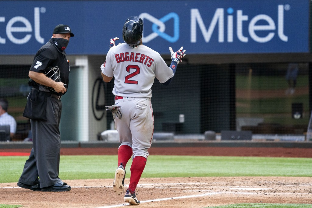 CORRECTS TO FOURTH INNING NOT THIRD INNING - Boston Red Sox's Xander Bogaerts (2) celebrates as he crosses the plate on a solo home run off Texas Rang...