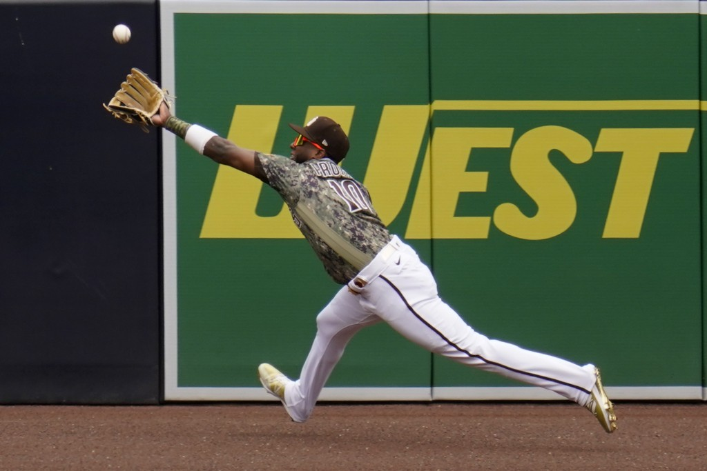 San Diego Padres left fielder Jurickson Profar makes the catch for the out on San Francisco Giants' Mike Tauchman during the first inning of a basebal...