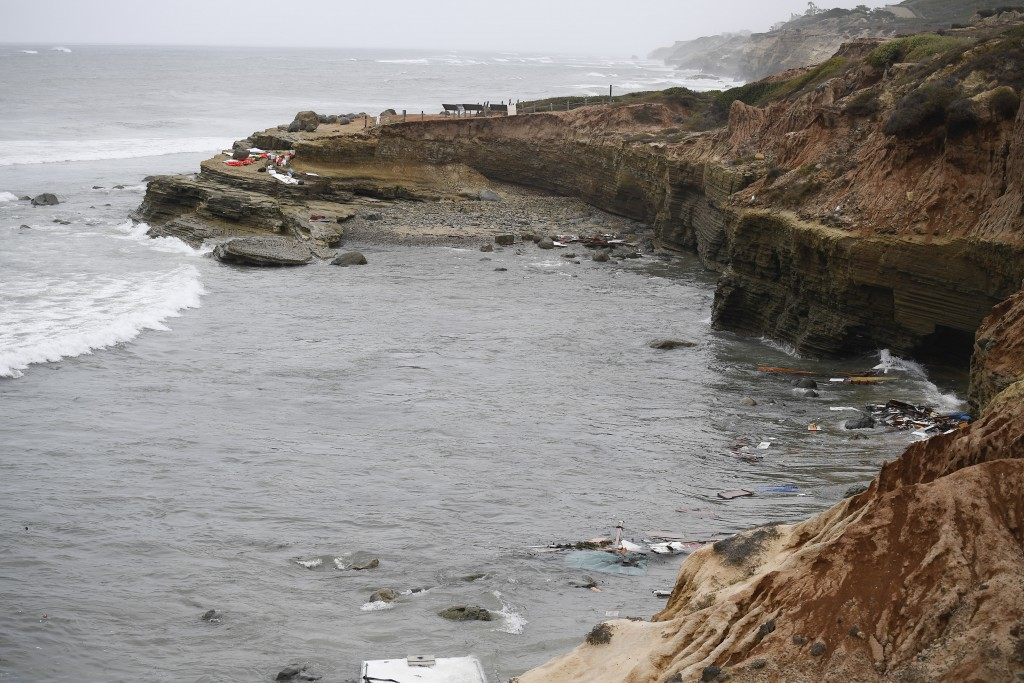 Wreckage and debris from a capsized boat washes ashore at Cabrillo National Monument near where a boat capsized just off the San Diego coast Sunday, M...