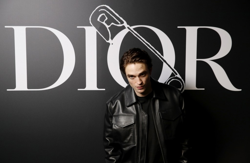 FILE - Actor Robert Pattinson arrives at the Dior Homme Mens Fall/Winter 2020-2021 fashion collection presented in Paris, Jan. 17, 2020. Pattinson tur...