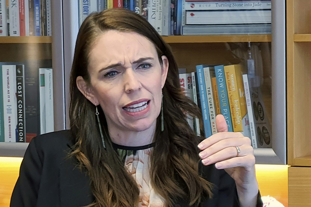 FILE - In this Dec. 16, 2020, file photo, New Zealand's Prime Minister Jacinda Ardern speaks during an interviewed in her office at the parliament in ...