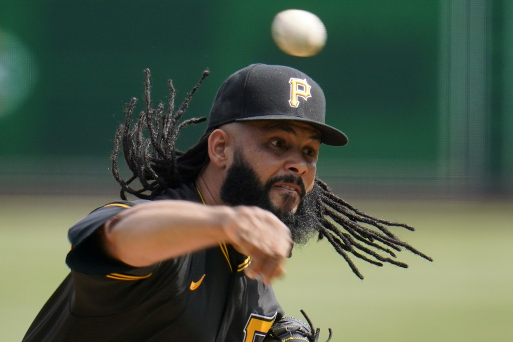 Pittsburgh Pirates relief pitcher Richard Rodriguez delivers during the ninth inning of a baseball game against the St. Louis Cardinals in Pittsburgh,...