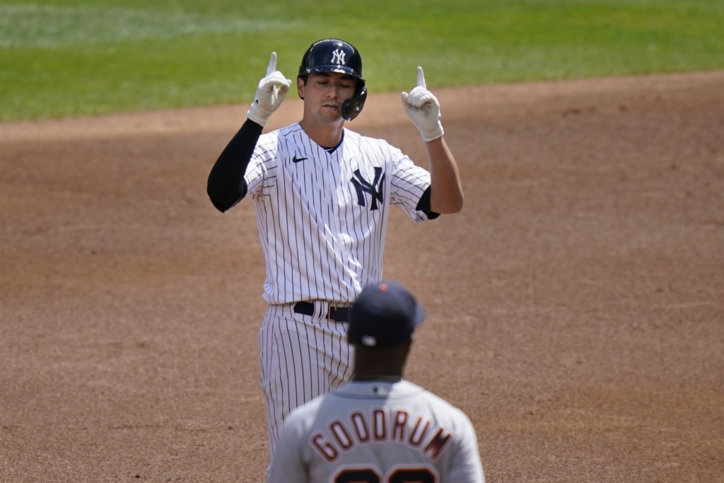 New York Yankees' Kyle Higashioka celebrates after his RBI-double during the second inning of a baseball game against the Detroit Tigers at Yankee Sta...