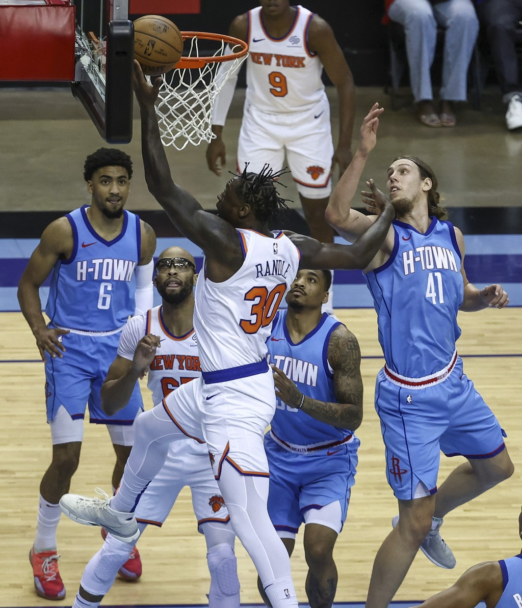 New York Knicks forward Julius Randle (30) shoots the ball as Houston Rockets forward Kelly Olynyk (41) defends during the first quarter of an NBA bas...