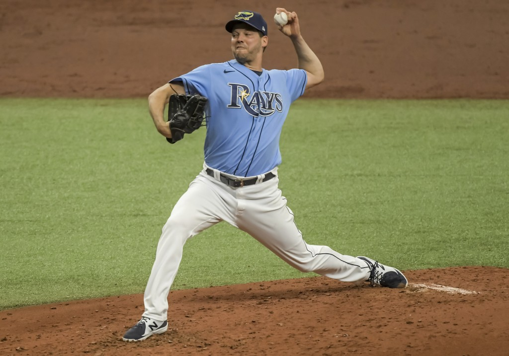 Tampa Bay Rays starter Rich Hill pitches against the Houston Astros during the third inning of a baseball game Sunday, May 2, 2021, in St. Petersburg,...