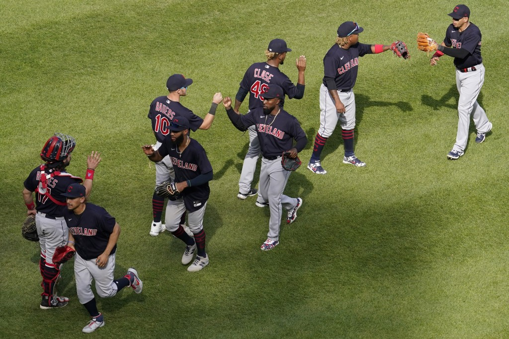 Cleveland Indians players celebrate after the Cleveland Indians defeated the Chicago White Sox in a baseball game in Chicago, Sunday, May 2, 2021. (AP...