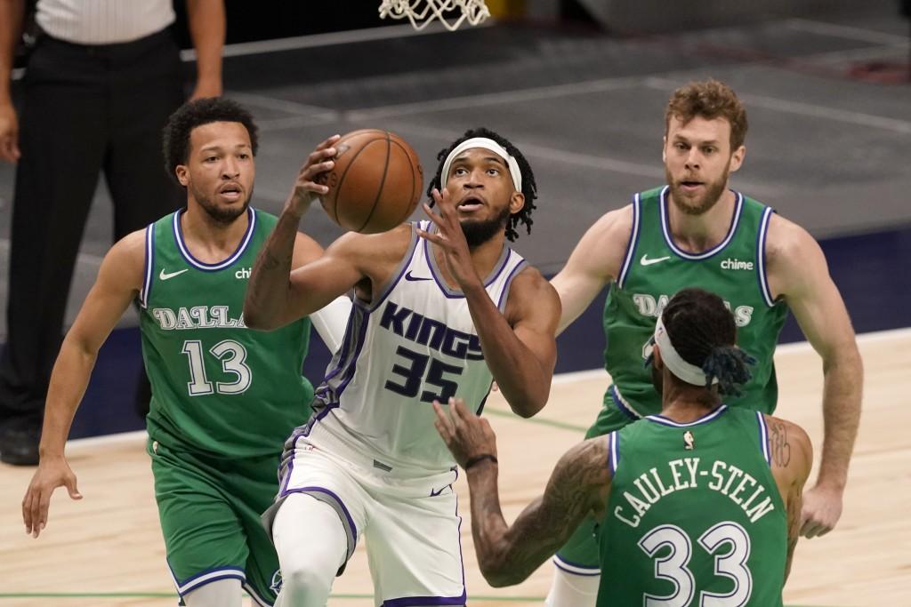 Sacramento Kings forward Marvin Bagley III (35) goes up for a shot between Dallas Mavericks' Jalen Brunson (13), Willie Cauley-Stein (33) and Nicolo M...