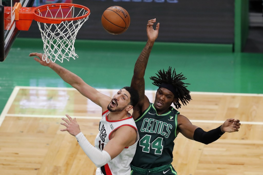 Portland Trail Blazers' Enes Kanter (11) and Boston Celtics' Robert Williams III (44) battle for a rebound during the second half of an NBA basketball...