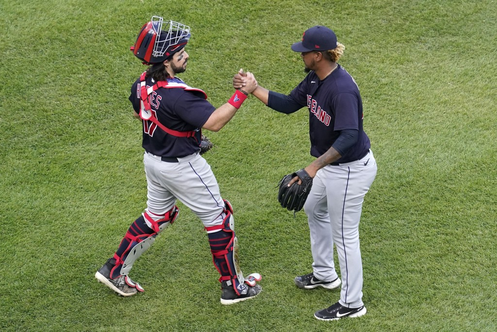 Cleveland Indians relief pitcher Emmanuel Clase, right, celebrates with catcher Austin Hedges after the Cleveland Indians defeated the Chicago White S...
