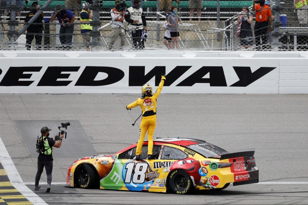 Kyle Busch, center, reacts after winning a NASCAR Cup Series auto race at Kansas Speedway in Kansas City, Kan., Sunday, May 2, 2021. (AP Photo/Colin E...