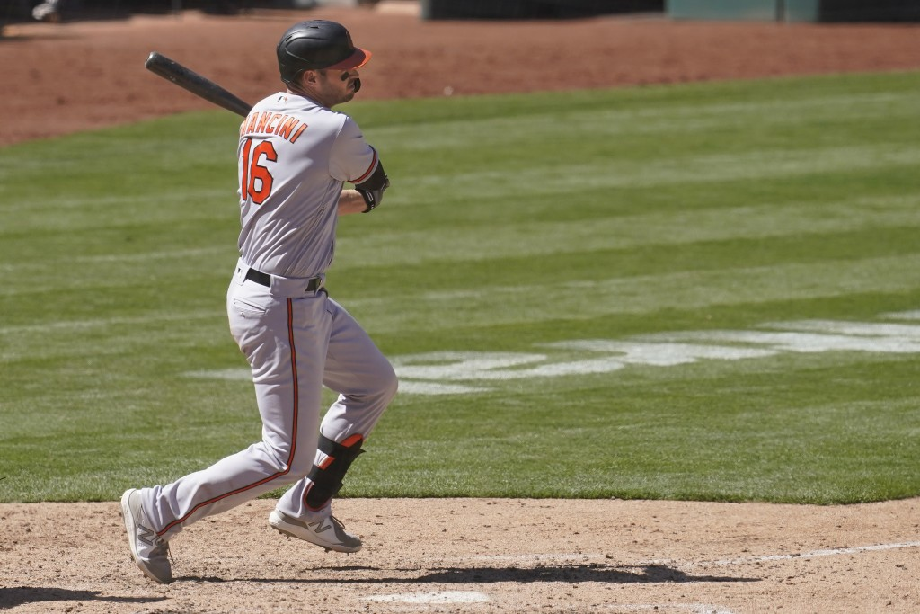 Baltimore Orioles' Trey Mancini hits an RBI-single against the Oakland Athletics during the seventh inning of a baseball game in Oakland, Calif., Sund...