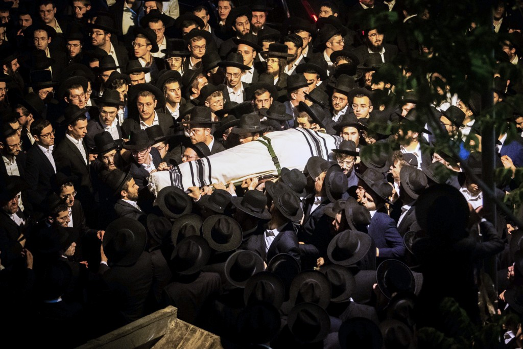 Ultra-Orthodox Jewish men carry the body of Yossi Kohn, 21, from Cleveland, Ohio, who died during Lag BaOmer celebrations at Mt. Meron in northern Isr...