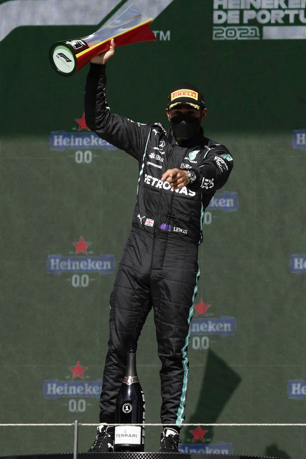 Mercedes driver Lewis Hamilton of Britain celebrates on the podium after winning the Portugal Formula One Grand Prix at the Algarve International Circ...