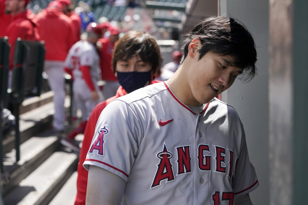 Los Angeles Angels Shohei Ohtani heads into the clubhouse at the end of the top of the first inning after being hit by a pitch but staying in the base...