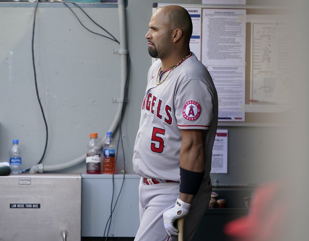 Los Angeles Angels Albert Pujols leans on his bat in the dugout during the eighth inning of a baseball game against the Seattle Mariners, Sunday, May ...