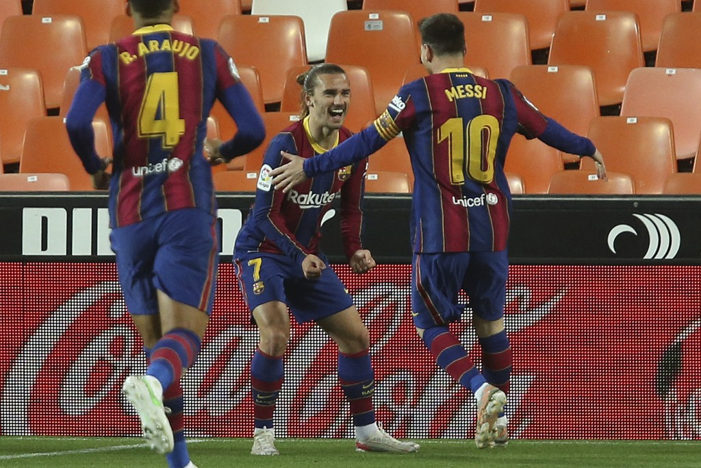 Barcelona's Antoine Griezmann celebrates with Lionel Messi scoring his side's 2nd goal during the Spanish La Liga soccer match between Valencia and Ba...