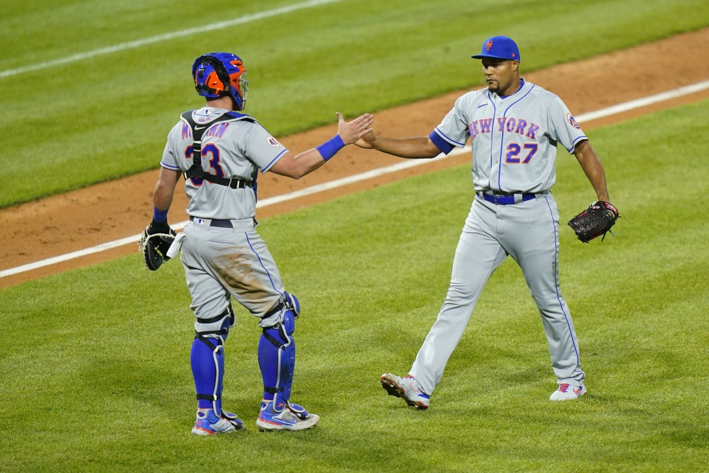 New York Mets pitcher Jeurys Familia, right, and catcher James McCann celebrate after a baseball game against the Philadelphia Phillies, Sunday, May 2...