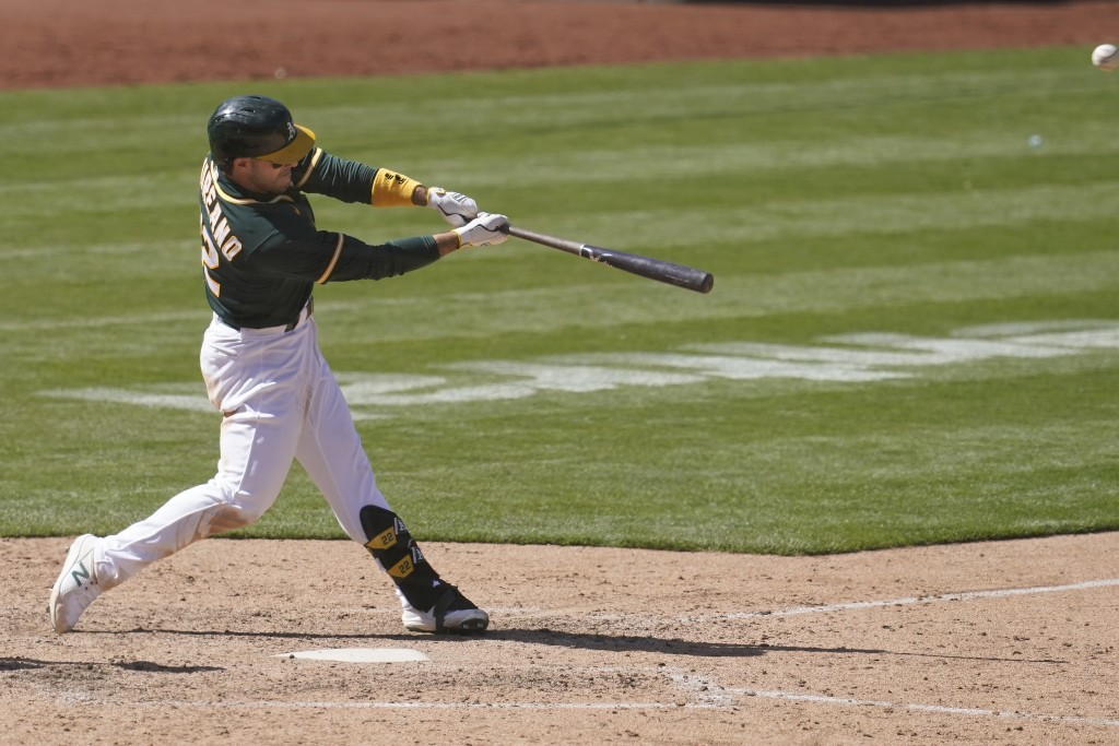 Oakland Athletics' Ramon Laureano hits a two-run home run against the Baltimore Orioles during the eighth inning of a baseball game in Oakland, Calif....