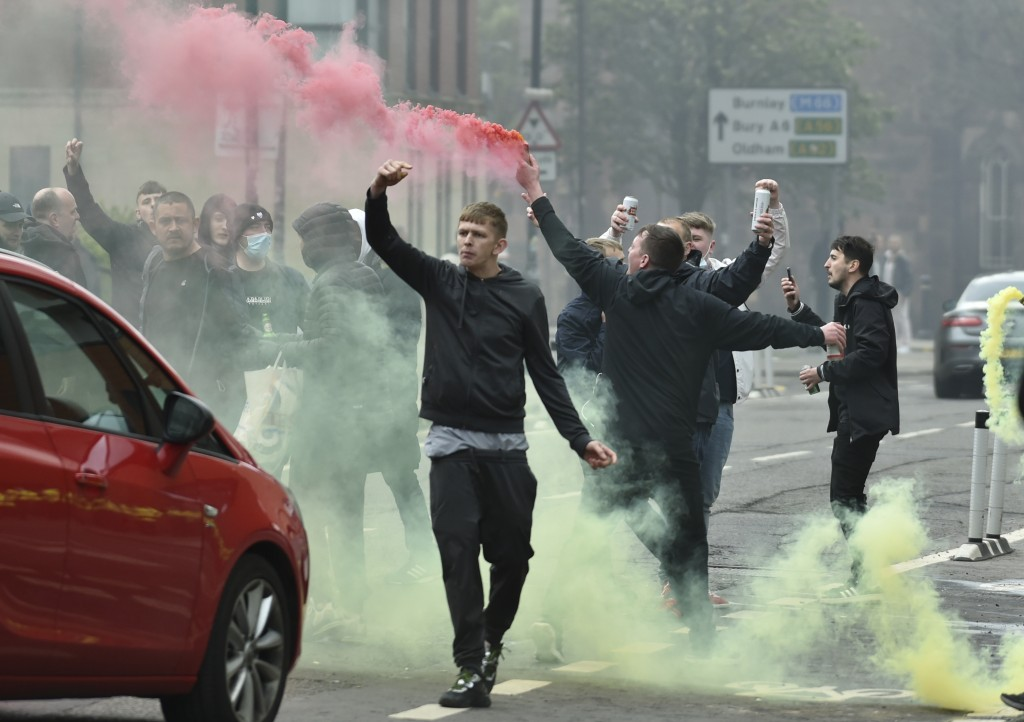 Manchester United fans protest outside the Lowry Hotel where team was staying during a protest against the Glazer family, owners of Manchester United,...