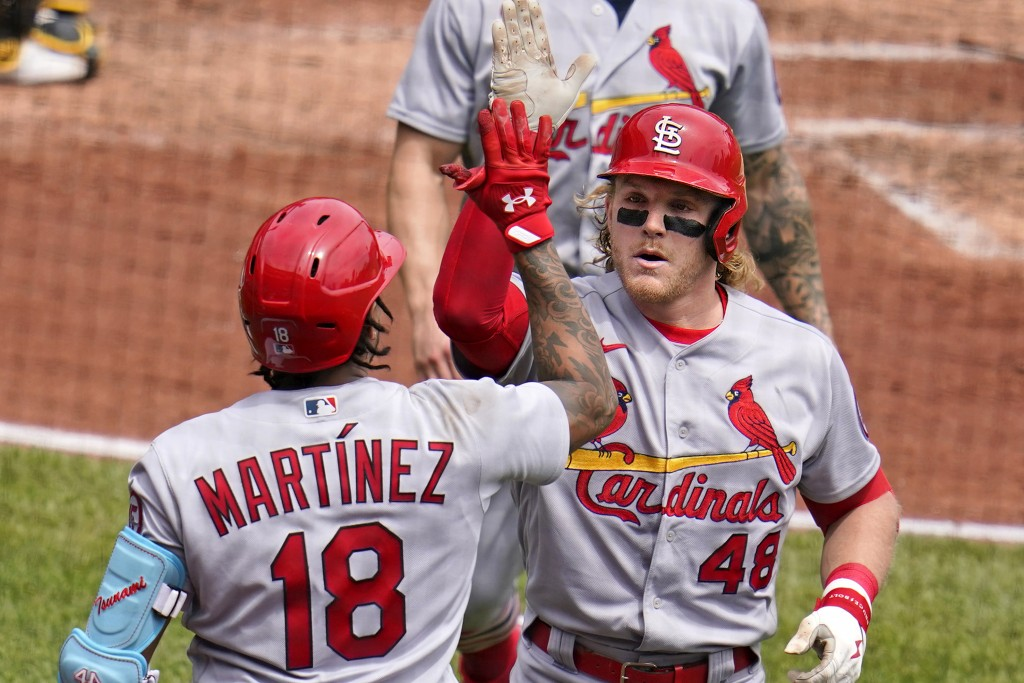 St. Louis Cardinals' Harrison Bader (48) is greeted by pitcher Carlos Martinez (18) as he returns to the dugout after hitting a three-run home run off...