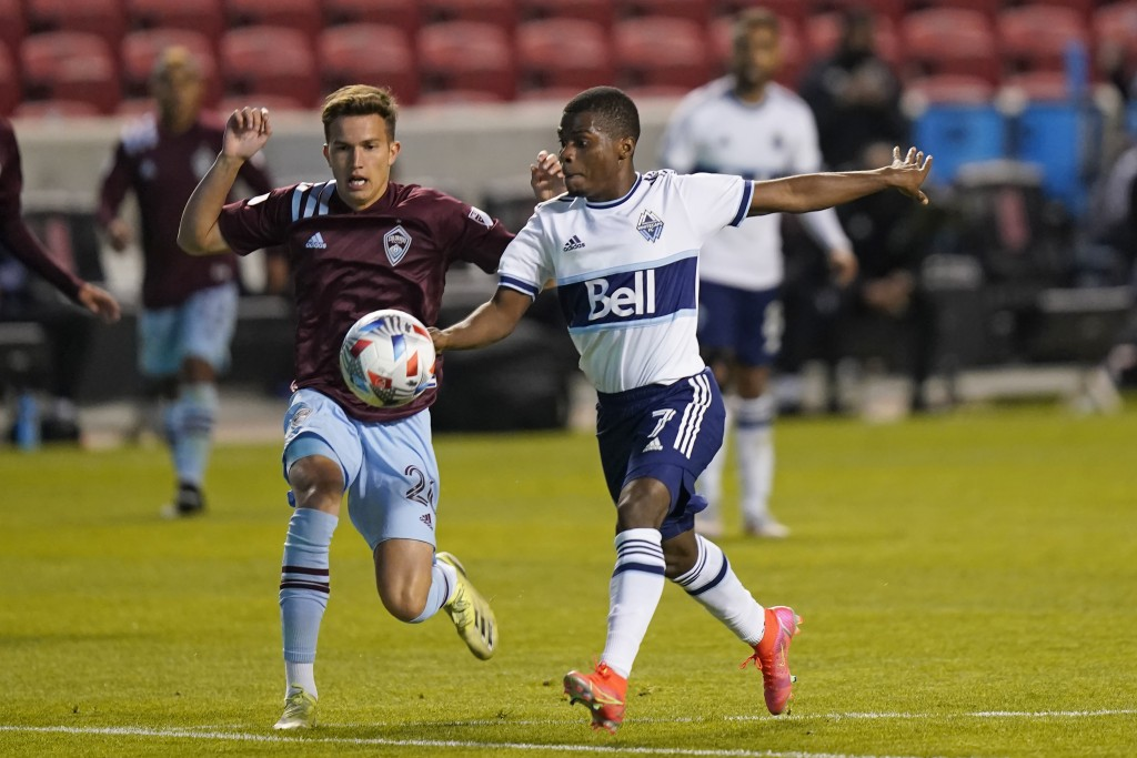 Vancouver Whitecaps forward Deiber Caicedo (7) controls the ball as Colorado Rapids midfielder Cole Bassett (26) defends in the second half of an MLS ...