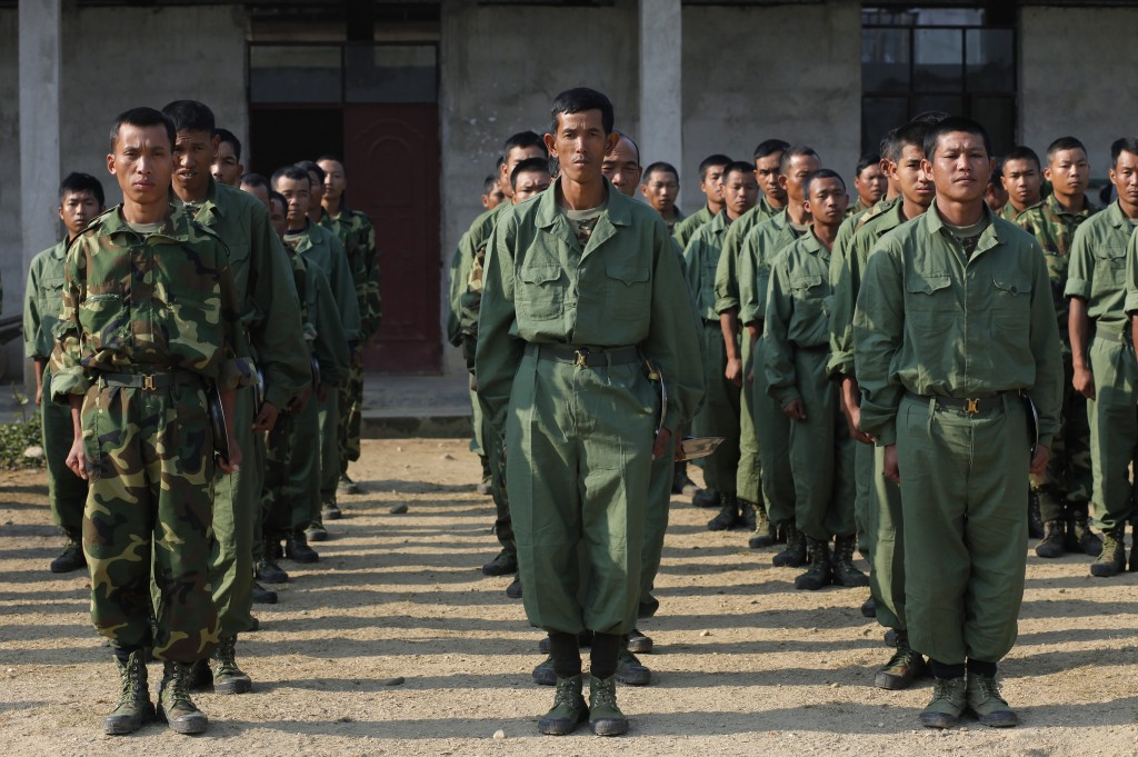 In this Feb. 13, 2012, file photo, recruits of the Kachin Independence Army, one of the country's largest armed ethnic groups, receive training at a m...