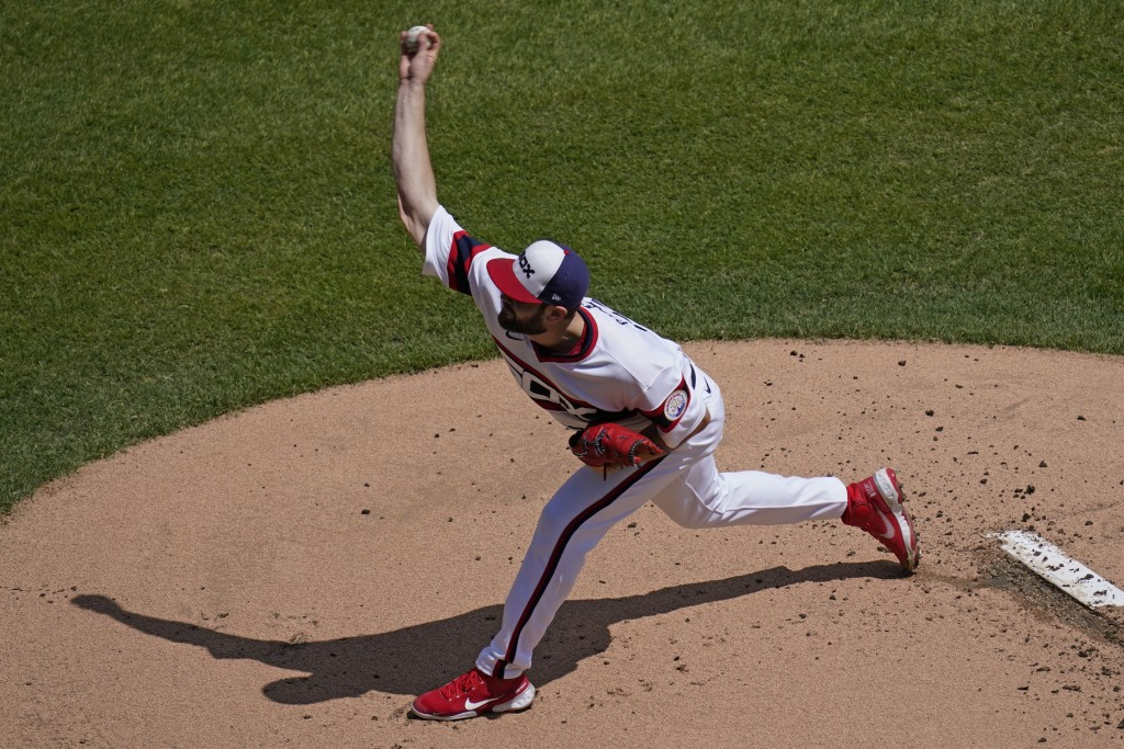 Chicago White Sox starting pitcher Lucas Giolito throws against the Cleveland Indians during the first inning of a baseball game in Chicago, Sunday, M...