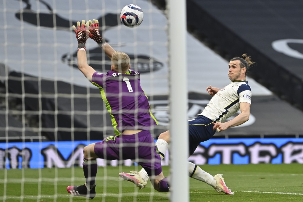 Tottenham's Gareth Bale scores his side's opening goal during the English Premier League soccer match between Tottenham and Sheffield United, at the T...