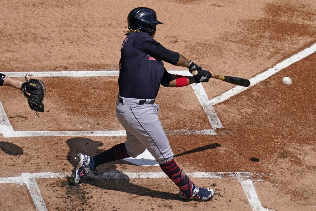 Cleveland Indians' Jose Ramirez hits a double during the first inning of a baseball game against the Chicago White Sox in Chicago, Sunday, May 2, 2021...