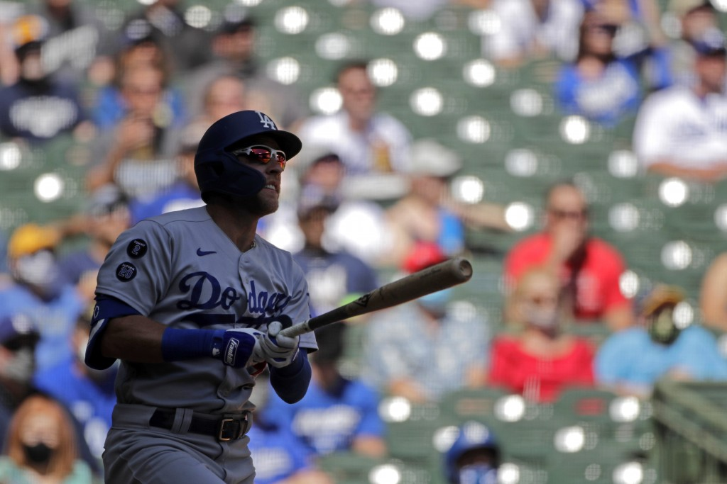 Los Angeles Dodgers' Matt Beaty watches his grand slam during the second inning of a baseball game against the Milwaukee Brewers Sunday, May 2, 2021, ...