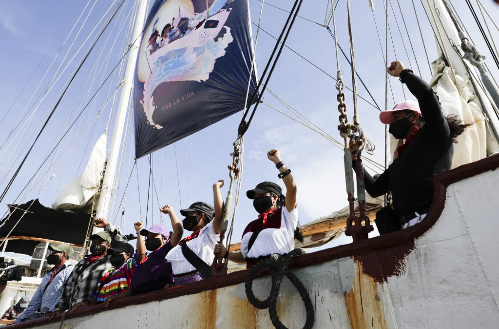 A delegation of the Zapatista Army of National Liberation, EZLN, say goodbye from a ship as they depart to Europe from Isla Mujeres, Quintana Roo stat...