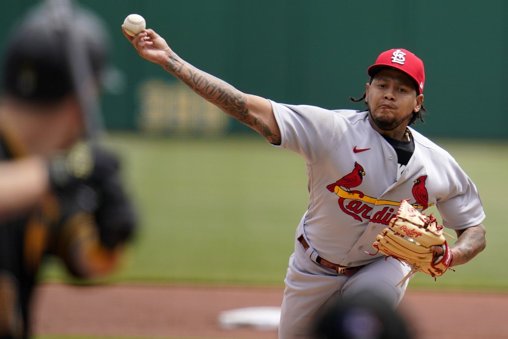 St. Louis Cardinals starting pitcher Carlos Martinez delivers during the first inning of a baseball game against the Pittsburgh Pirates in Pittsburgh,...