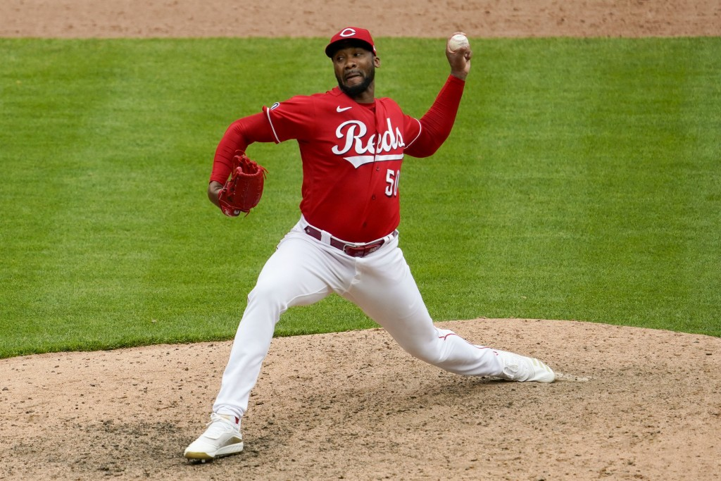 Cincinnati Reds relief pitcher Amir Garrett throws in the 10th inning during a baseball game against the Chicago Cubs in Cincinnati on Sunday, May 2, ...