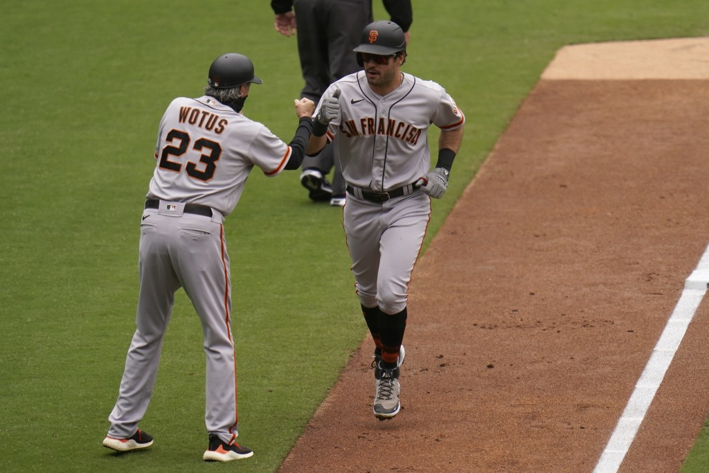 San Francisco Giants' Mike Tauchman, right, is greeted by third base coach Ron Wotus (23) after hitting a three-run home run during the third inning o...