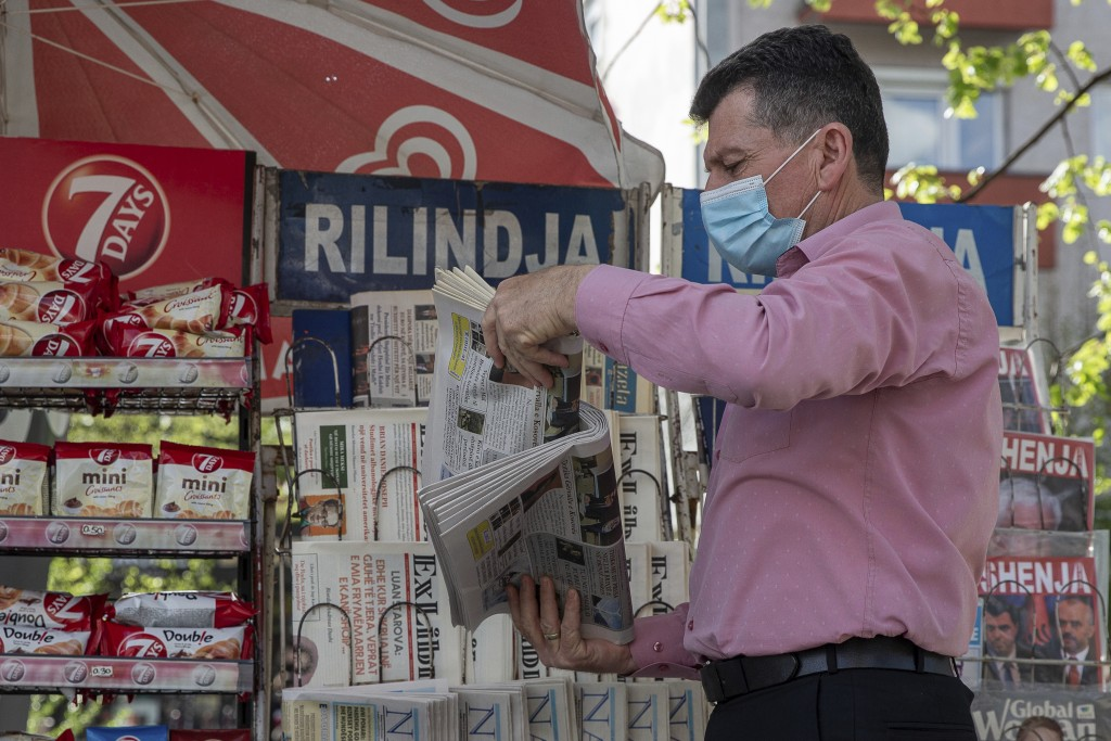 Vendor Ibrahim Gashi, arranges weekly and monthly magazines at his newspaper kiosk were he has been selling newspapers downtown for 35 consecutive yea...