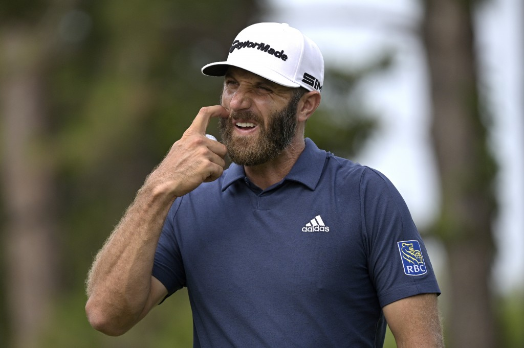 Dustin Johnson reacts after putting on the sixth green during the final round of the Valspar Championship golf tournament, Sunday, May 2, 2021, in Pal...