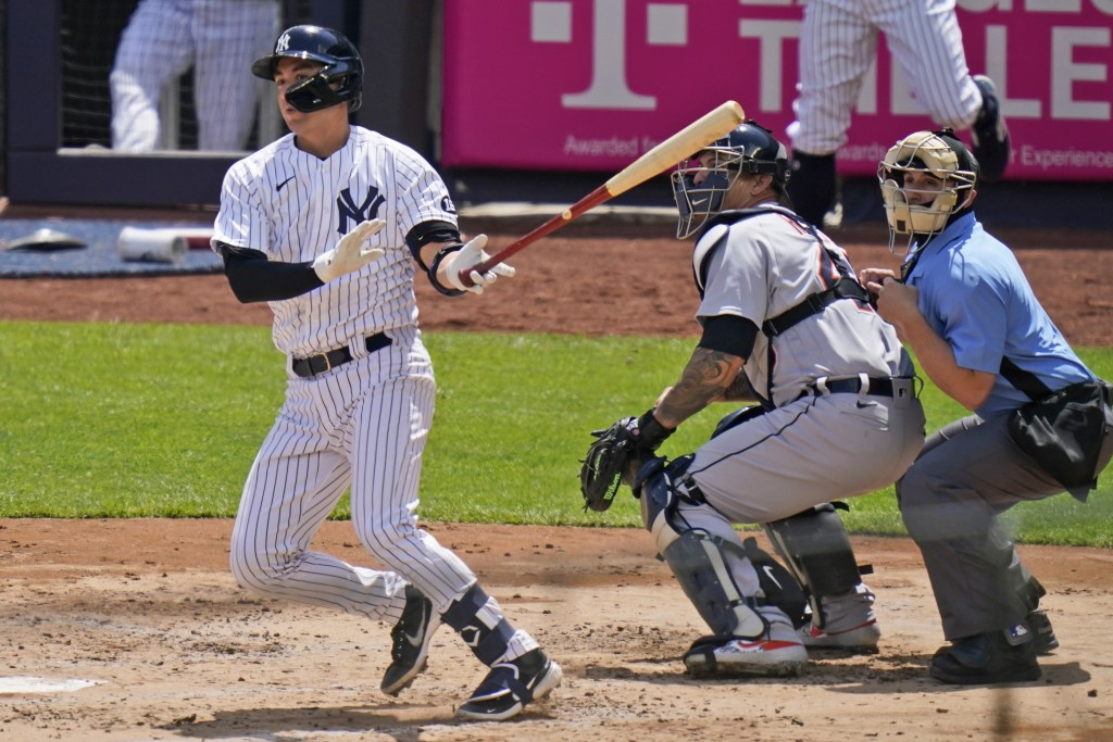 New York Yankees' Kyle Higashioka watches his RBI-double during the second inning of a baseball game against the Detroit Tigers at Yankee Stadium, Sun...